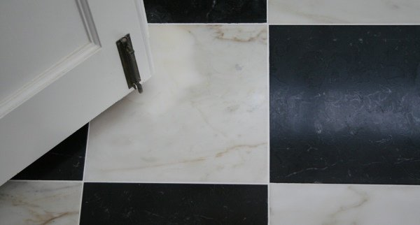 Honed black and white marble floor tiles
