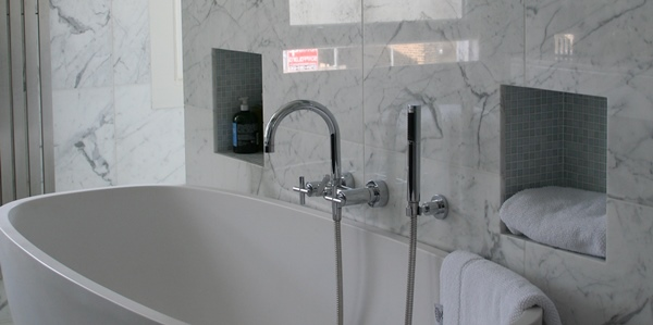 Polished Statuario marble bathroom tiles