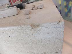 damaged corner of limestone altar resized 600