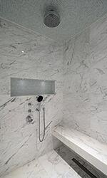 Statuario Italian marble shower enclosure with marble shower bench