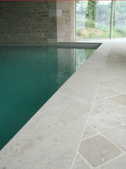 ROCHEVILLE  - antiqued French limestone paving and bespoke pool copings