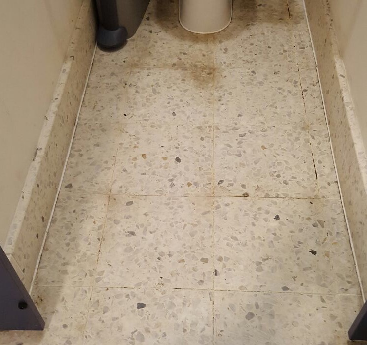 Restoration of a terrazzo floor - before cleaning