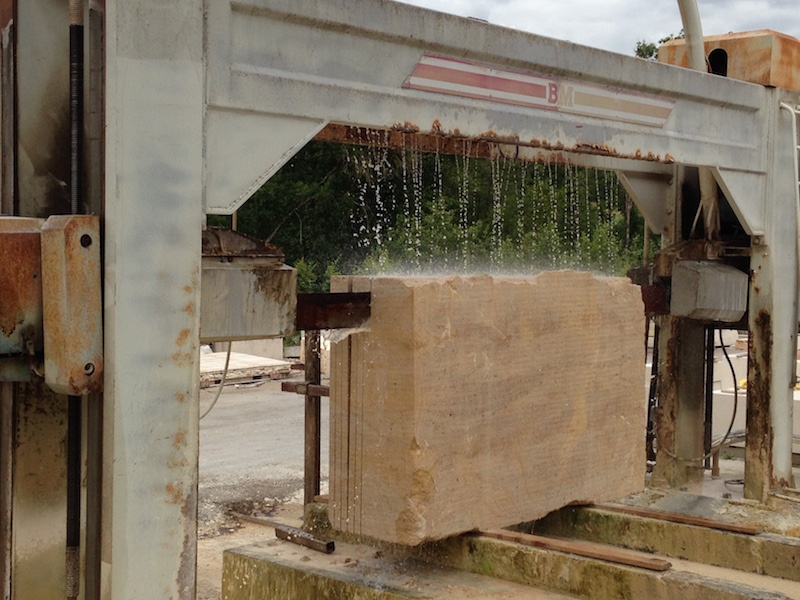 Cutting a block of French limestone into slabs