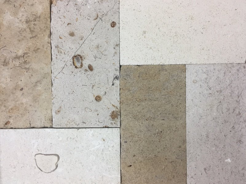 A mix of French limestone flooring stone to create the look of reclaimed stone